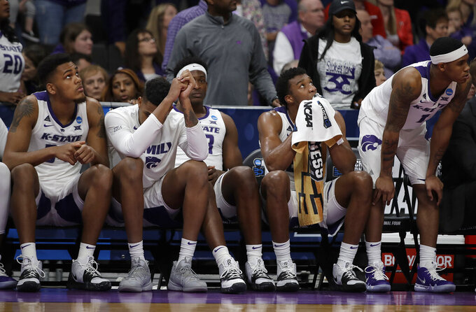 Kansas State players react on the bench during the second half of a first round men's college basketball game against UC Irvine in the NCAA Tournament Friday, March 22, 2019, in San Jose, Calif. (AP Photo/Ben Margot)