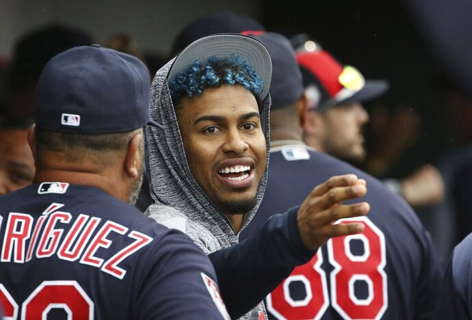 FILE - In this Monday, March 11, 2019, file photo, injured Cleveland Indians shortstop Francisco Lindor talks to a teammate in the dugout during the fourth inning of a spring training baseball game against the Cincinnati Reds in Goodyear, Ariz. Lindor will take a major step in his recovery from a calf strain by playing in a controlled minor league game. (AP Photo/Ross D. Franklin, File)