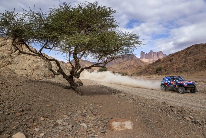 Driver Jakub Przygonski, of Poland, and co-driver Timo Gottschalk, of Germany, race their Mini during stage four of the Dakar Rally between Neom and Al Ula, in Saudi Arabia, Wednesday, Jan. 8, 2020. (AP Photo/Bernat Armangue)