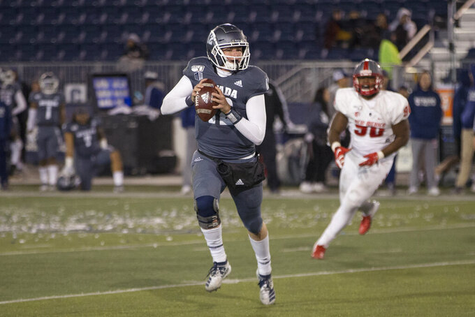 Nevada quarterback Carson Strong (12 ) rolls out against New Mexico second half of an NCAA college football game in Reno, Nev., Saturday, Nov. 2, 2019. (AP Photo/Tom R. Smedes)