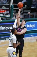 Penn State's John Harrar, right, shoots against Michigan State's Marcus Bingham Jr. during the first half of an NCAA college basketball game, Tuesday, Feb. 9, 2021, in East Lansing, Mich. Michigan State won 60-58. (AP Photo/Al Goldis)