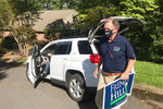 U.S. Rep. French Hill delivers campaign signs at a home in Little Rock, Ark., on Aug. 28, 2020. Hill, a Republican, is being challenged by Democratic state Sen. Joyce Elliott in the November election.  (AP Photo/Andrew Demillo)