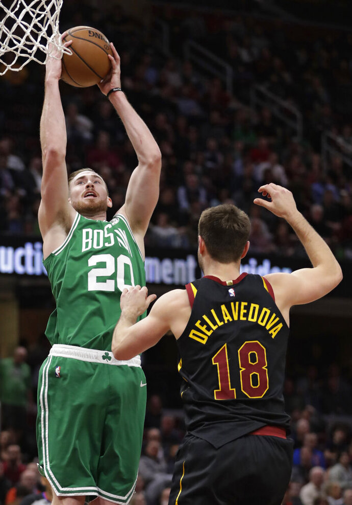 Boston Celtics' Gordon Hayward (20) drives to the basket against Cleveland Cavaliers' Matthew Dellavedova (18) during the first half of an NBA basketball game Tuesday, Feb. 5, 2019, in Cleveland. (AP Photo/Tony Dejak)