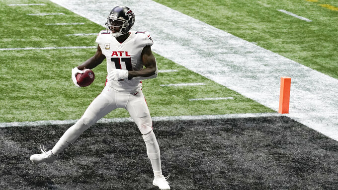 Atlanta Falcons wide receiver Julio Jones (11) lands in the end zone for a touchdown against the Denver Broncosduring the second half of an NFL football game, Sunday, Nov. 8, 2020, in Atlanta. (AP Photo/Brynn Anderson)