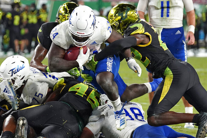 Tulsa running back Corey Taylor II (24) gets past South Florida defensive back Mekhi LaPointe (22) to score a touchdown during the second half of an NCAA college football game Friday, Oct. 23, 2020, in Tampa, Fla. (AP Photo/Chris O'Meara)