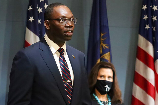 FILE - In this Sept. 10, 2020, file photo, provided by the Michigan Office of the Governor, Michigan Lt. Gov. Garlin Gilchrist II, accompanied by Gov. Gretchen Whitmer, right, speaks during an address to the state in Lansing, Mich. Michigan reported Monday, Sept. 28, 2020 that Black residents are no longer being disproportionately infected and killed by the coronavirus, after they accounted for a staggering 40% of deaths and 29% of cases in the early days of the pandemic. Gilchrist credits people of color for being more likely to wear masks and follow safety guidelines. (Michigan Office of the Governor via AP File)