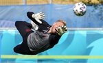 Denmark's goalkeeper Kasper Schmeichel exercises during a training session at the training ground in Helsingor, Denmark, Sunday, June 20, 2021 the day before the Euro 2020 soccer championship group B match between Denmark and Russia. (AP Photo/Martin Meissner)