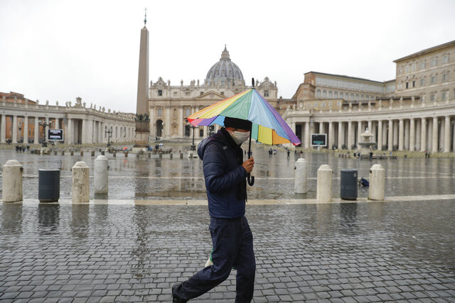 A man walks past an almost empty St. Peter's Square at the Vatican, Sunday, Jan. 24, 2021. Ailing Pope Francis, making limited public appearances due to persistent pain, drew attention to the plight of homeless people in winter, including a Nigerian man who froze to death not far from the Vatican. Francis on Sunday asked for prayers for the man, who he said was 46, named Edwin, and who was