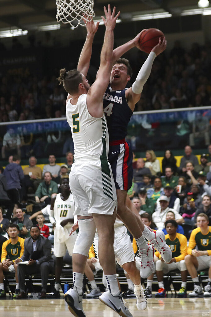 Gonzaga forward Corey Kispert (24) shoots against San Francisco center Jimbo Lull (5) during the first half of an NCAA college basketball game in San Francisco, Saturday, Feb. 1, 2020. (AP Photo/Jed Jacobsohn)