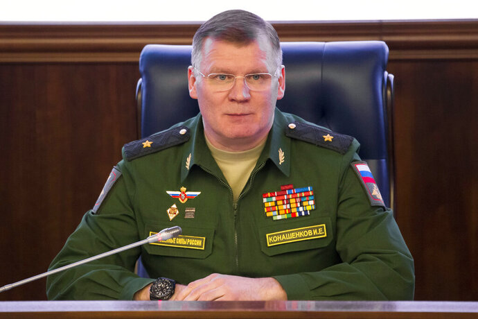 FILE - In this April 13, 2018 file photo, Russian Defense Ministry spokesman, Maj. Gen. Igor Konashenkov, speaks at a briefing in Moscow. Russia's Defense Ministry says Israeli air forces nearly shot down a passenger jetliner in Syria during a missile strike on the suburbs of Damascus.  In a statement released Friday, Feb. 7, 2020, Konashenkov said the strike was carried around 2 a.m. local time Thursday. Israel did not respond to a request for comment. (AP Photo/Alexander Zemlianichenko, File)