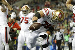 San Francisco 49ers' Joe Staley spikes the football after a touchdown run by Raheem Mostert against the Seattle Seahawks during the second half of an NFL football game, Sunday, Dec. 29, 2019, in Seattle. (AP Photo/Ted S. Warren)