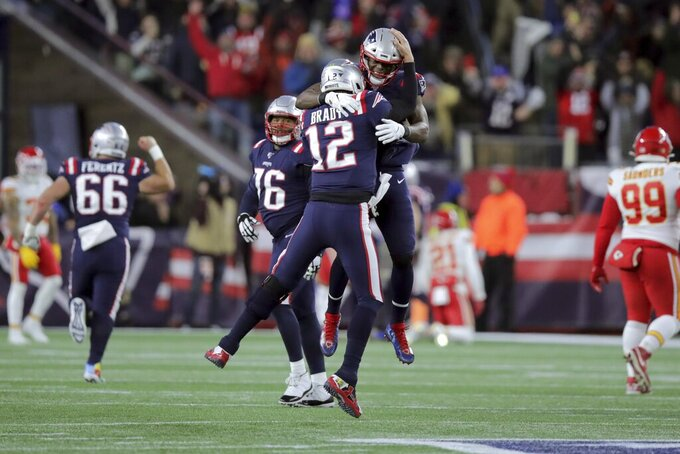 New England Patriots quarterback Tom Brady (12) celebrates his touchdown pass to Julian Edelman with tight end Benjamin Watson, rear, in the first half of an NFL football game against the Kansas City Chiefs, Sunday, Dec. 8, 2019, in Foxborough, Mass. (AP Photo/Charles Krupa)