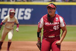 Oklahoma's Giselle Juarez (45) reacts after striking out Florida State's Cassidy Davis to end the first half of the first inning of the final game of the NCAA Women's College World Series softball championship series Thursday, June 10, 2021, in Oklahoma City. (AP Photo/Sue Ogrocki)