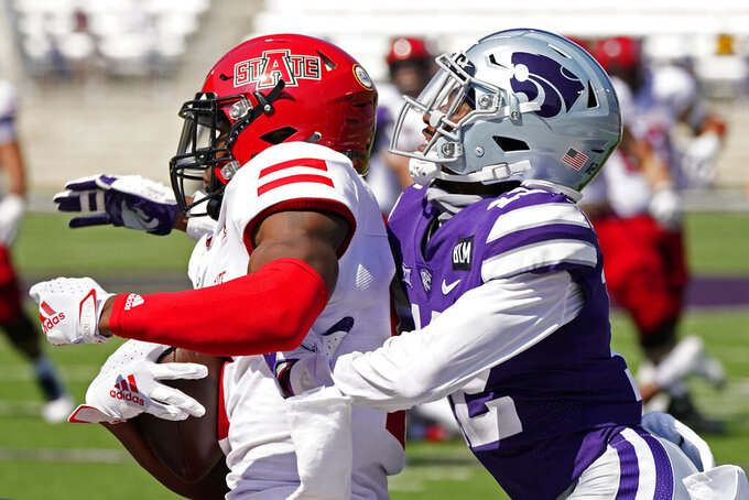 Arkansas State wide receiver Jonathan Adams Jr., left, catches a pass under pressure from Kansas State defensive back AJ Parker (12) to score the winning touchdown during the second half of an NCAA college football game Saturday, Sept. 12, 2020, in Manhattan, Kan. (AP Photo/Charlie Riedel)