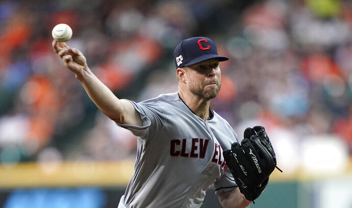 FILE - In this April 26, 2019, file photo, Cleveland Indians starting pitcher Corey Kluber throws against the Houston Astros during the first inning of a baseball game in Houston. The Cleveland Indians say pitcher Corey Kluber threw a successful bullpen session at Progressive Field, the right-hander's first time throwing from a mound since fracturing his right forearm on May 1. The team said the two-time Cy Young Award winner fired 20 fastballs, as scheduled, before Cleveland's game against Detroit on Wednesday, July 17, 2019. (AP Photo/David J. Phillip, File)