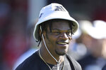 "FILE - In this Jan. 25, 2020, file photo, AFC quarterback Lamar Jackson of the Baltimore Ravens smiles during Pro Bowl NFL football practice in Kissimmee, Fla. Lamar Jackson announced he will hold his annual ""Funday with LJ"" event in Florida amid the state's spike in coronavirus cases. Jackson's third annual event will be held Saturday and Sunday in his hometown of Pompano Beach, Florida, according to a flyer shared on his Instagram page Monday, July 6, 2020. Social gatherings in groups of more than 10 people is currently not allowed in Pompano Beach, according to the city's website.(AP Photo/Gregory Payan, File)"