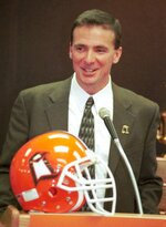 FILE - In this Dec. 4, 2000, file photo, Bowling Green State University's new head football coach Urban Meyer speaks during an introductory press conference in Bowling Green, Ohio. Meyer, the highly successful football coach who won three national championships and sparked controversy and criticism this season for his handling of domestic violence allegations against a now-fired assistant, will retire after the Rose Bowl, Ohio State University announced Tuesday, Dec. 4, 2018. He started his head-coaching career at Bowling Green. (J.D. Pooley/Sentinel-Tribune via AP, File)