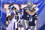 Dallas Cowboys tight end Blake Jarwin, center, celebrates with wide receiver Tavon Austin after scoring a touchdown against the New York Giants during the second quarter of an NFL football game, Monday, Nov. 4, 2019, in East Rutherford, N.J. (AP Photo/Bill Kostroun)
