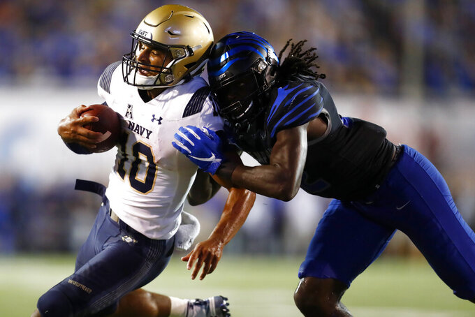 Memphis defensive back Tyrez Lindsey tackles Navy quarterback Malcolm Perry during an NCAA college football game in Memphis, Tenn., Thursday, Sept. 26, 2019. (Joe Rondone/The Commercial Appeal via AP)