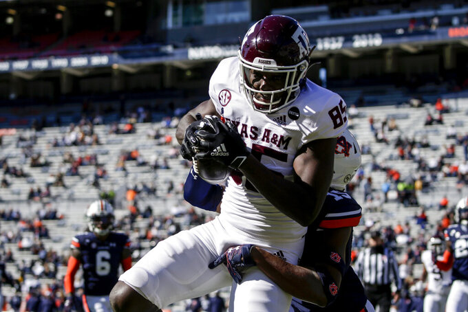 Texas A&M tight end Jalen Wydermyer (85) catches a pass over Auburn defensive back Jordyn Peters (15) for a touchdown during the first half of an NCAA college football game on Saturday, Dec. 5, 2020, in Auburn, Ala. (AP Photo/Butch Dill)