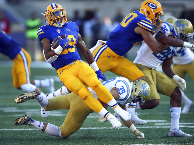 California running back Marcel Dancy, front left, gets turned around by UCLA's Ethan Fernea (39) during the first half of an NCAA college football game Saturday, Oct. 13, 2018, in Berkeley, Calif. (AP Photo/Ben Margot)