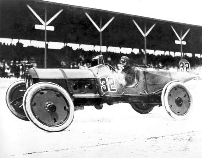 FILE - In this May 10, 1911, file photo, Ray Harroun wheels his No. 32 Marmon Wasp race car to victory in the inaugural Indianapolis 500-mile race, called the International 500 Mile Sweepstakes, on the Brickyard at the Indianapolis Motor Speedway in Indianapolis, Ind. Indianapolis Motor Speedway and the IndyCar Series have been sold to Penske Entertainment Corp. in a stunning announcement that relinquishes control of the iconic speedway from the Hulman family after 74 years. (AP Photo)