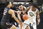 South Carolina's Jair Bolden (52), Justin Minaya, center, and Vanderbilt's Ejike Obinna (50) fight for the ball in the second half of an NCAA college basketball game Saturday, March 7, 2020, in Nashville, Tenn. (AP Photo/Mark Humphrey)