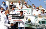 Medical workers hold placards while staging a sit-in protest at the Unknown Soldier Square in Gaza City, Wednesday, Oct. 21, 2020. Arabic reads