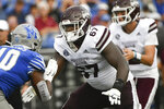 Mississippi State offensive lineman Charles Cross (67) blocks during the first half of an NCAA college football game against Memphis, Saturday, Sept. 18, 2021, in Memphis, Tenn. (AP Photo/John Amis)