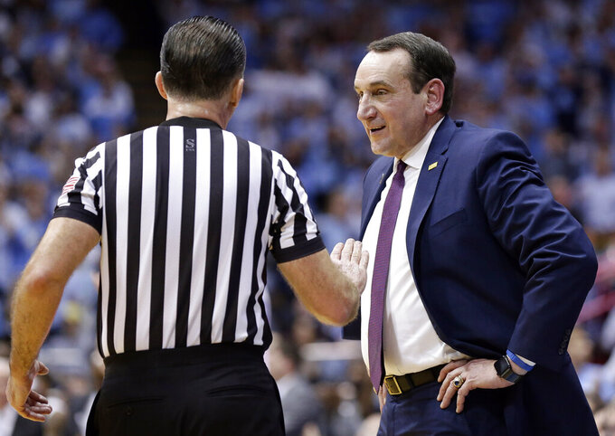 Duke coach Mike Krzyzewski speaks with an official during the second half of the team's NCAA college basketball game against North Carolina in Chapel Hill, N.C., Saturday, March 9, 2019. North Carolina won 79-70. (AP Photo/Gerry Broome)