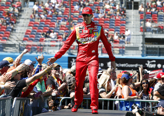 Kyle Busch is greeted by fans during driver introductions prior to the start of the NASCAR Cup Series auto race at ISM Raceway, Sunday, March 10, 2019, in Avondale, Ariz. (AP Photo/Ralph Freso)