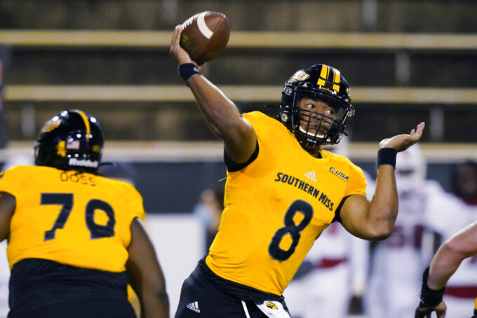 Southern Mississippi quarterback Trey Lowe throws a pass against Florida Atlantic during the first half of an NCAA college football game Thursday, Dec. 10, 2020, in Hattiesburg, Miss. (AP Photo/Rogelio V. Solis)