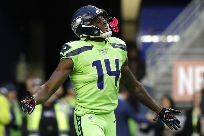 Seattle Seahawks wide receiver DK Metcalf celebrates his touchdown against the Los Angeles Rams during the first half of an NFL football game Thursday, Oct. 3, 2019, in Seattle. (AP Photo/Elaine Thompson)