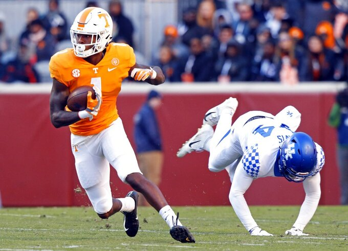 Tennessee wide receiver Marquez Callaway (1) escapes from Kentucky linebacker Jamin Davis (44) in the first half of an NCAA college football game Saturday, Nov. 10, 2018, in Knoxville, Tenn. (AP Photo/Wade Payne)