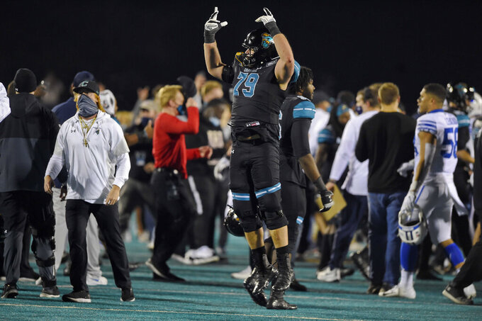 Coastal Carolina's Steven Bedosky (79) celebrates after the team's NCAA college football game against BYU on Saturday, Dec. 5, 2020, in Conway, S.C. Coastal Carolina won 22-17. (AP Photo/Richard Shiro)