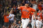 Houston Astros' Carlos Correa reacts after scoring on Aledmys Diaz's two-run single during the fourth inning of a baseball game against the Los Angeles Angels, Friday, Sept. 10, 2021, in Houston. (AP Photo/Eric Christian Smith)