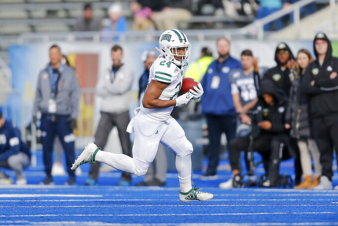 Ohio running back De'Montre Tuggle (24) runs the ball against Nevade in the first half of the Famous Idaho Potato Bowl NCAA college football game Friday, Jan. 3, 2020, in Boise, Idaho. (AP Photo/Steve Conner)