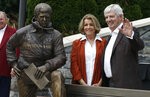 Former Virginia Tech head football coach Frank Beamer, right, and his wife Cheryl, pose next to a statue dedicated to him in front of Lane Stadium in Blacksburg, Va., Saturday, Oct. 6, 2018. (AP Photo/Steve Helber)