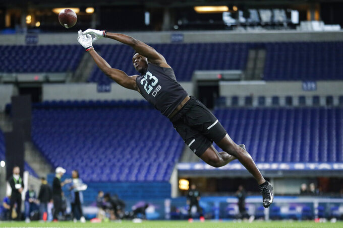 Iowa defensive back Michael Ojemudia runs a drill at the NFL football scouting combine in Indianapolis, Sunday, March 1, 2020. (AP Photo/Michael Conroy)