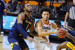 Oklahoma State guard Cade Cunningham (2) drives past West Virginia forward Derek Culver (1) in the second half of an NCAA college basketball game Monday, Jan. 4, 2021, in Stillwater, Okla. (AP Photo/Sue Ogrocki)