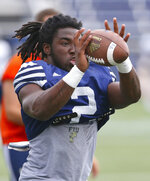 FILE - In this Thursday, Aug. 11, 2016, file photo, Florida International running back Anthony Jones catches a pass during an NCAA college football practice at Ocean Bank Field at FIU Stadium, in Miami. Jones and a teammate were hurt in a drive-by shooting on Sept. 6, 2018. Jones' wounds have healed and he's playing in the Bahamas Bowl on Friday, Dec. 21, as FIU takes on Toledo. (David Santiago/El Nuevo Herald via AP, File)