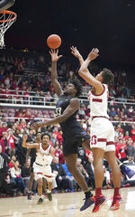 Washington forward Isaiah Stewart (33) shoots against Stanford forward Oscar da Silva (13) during the first half of an NCAA college basketball game Thursday, Jan. 9, 2020, in Stanford, Calif. (AP Photo/Tony Avelar)