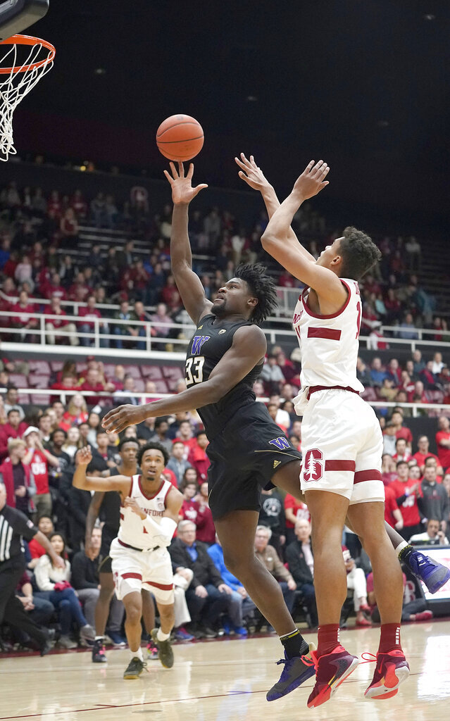Washington forward Isaiah Stewart (33) shoots against Stanford forward Oscar da Silva (13) during the first half of an NCAA college basketball game Thursday, Jan. 9, 2020, in Stanford, Calif. (AP Photo/Tony Avelar)