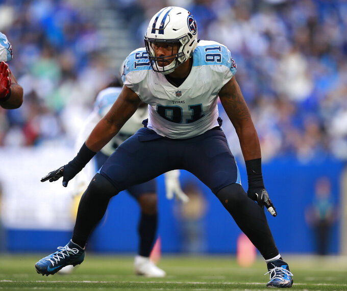 FILE - In this Nov. 26, 2017, file photo, Tennessee Titans outside linebacker Derrick Morgan (91) lines up against the Indianapolis Colts during an NFL football game, in Indianapolis. Tennessee defensive lineman Derrick Morgan says he's retiring after playing nine NFL seasons for five head coaches. Morgan announced his decision Monday, July 15, 2019, on social media and with a post at The Players Tribune. (Jeff Haynes/AP Photo, File)