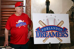 Pat Williams, co-founder of the NBA Orlando Magic basketball team, wears a T-shirt and hat with the logo 'Orlando Dreamers' while speaking at a news conference to announce a campaign to bring a Major League Baseball team to Orlando, Wednesday, Nov. 20, 2019 in Orlando, Fla.. (AP Photo/John Raoux)