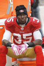 FILE - In this Oct. 17, 2010 file photo, San Francisco 49ers cornerback Phillip Adams (35) sits on the sideline during the first quarter of an NFL football game in San Francisco. A source briefed on a mass killing in South Carolina says the gunman who killed multiple people, including a prominent doctor, was the former NFL pro.  The source tells AP that Adams shot himself to death early Thursday, April 8, 2021. (AP Photo/Paul Sakuma, File)