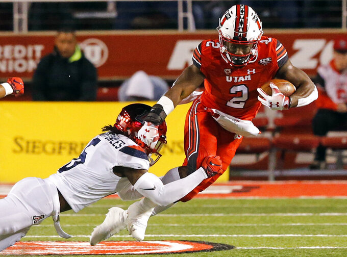 FILE - In this Oct. 12, 2018, file photo, Arizona safety Demetrius Flannigan-Fowles (6) tackles Utah running back Zack Moss (2) during the first half during an NCAA college football game, in Salt Lake City. Utah is seeking a ninth consecutive victory over in-state rival BYU. The Cougars are looking to spring an upset on the defending Pac-12 South champs to kick off a tough four-game stretch. (AP Photo/Rick Bowmer, File)