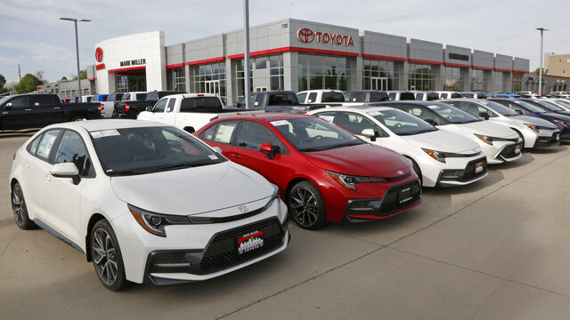 FILE - In this May 12, 2020 photo, Toyota's are shown on the lot of Mark Miller Toyota Dealership in Salt Lake City.  One of COVID-19′s impacts has been the reduction in interest rates, including those for auto loans. In June 2020, the average interest rate for new auto loans decreased to 4.2%, down from 6.0% one year ago, according to Edmunds.  But Americans are buying more expensive vehicles, which means monthly payments have increased year over year. (AP Photo/Rick Bowmer)