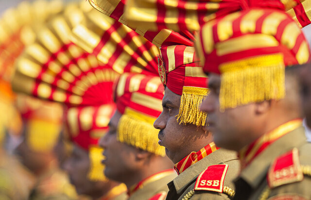 An Indian Sashastra Seema Bal paramilitary soldier breathes through mouth as he participates in a parade to mark Republic Day in Gauhati, India, Sunday, Jan. 26, 2020. Sunday's event marks the anniversary of the country's democratic constitution taking force in 1950. (AP Photo/Anupam Nath)