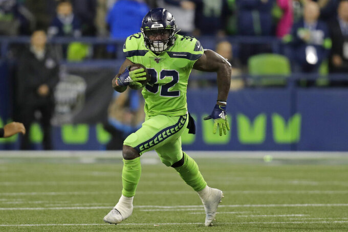 Seattle Seahawks running back Chris Carson rushes against the Los Angeles Rams during the second half of an NFL football game Thursday, Oct. 3, 2019, in Seattle. (AP Photo/Stephen Brashear)